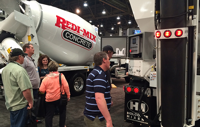 Attendees at World of Concrete scope out the Beck Industrial 10.5 half yard paver mixer with a Freightliner 114SD set back axle.