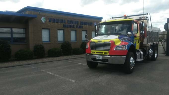 The Autism Speaks dump truck in front of Virginia Paving Company.